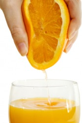 Extracting juice from an orange.