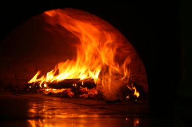 An inferno blazes within an oven.