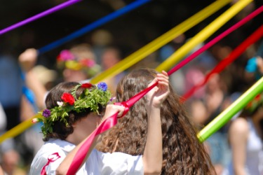 Maypole dancing is an example of maying.