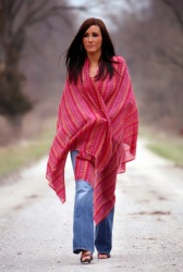 A woman wearing a red shawl.