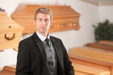 An undertaker with a display of coffins.