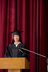 The valedictorian speaks at her graduation.
