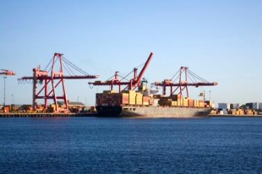 A ship unloading at a wharf.