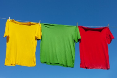 Shirts hanging on a line to air-dry.