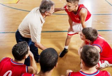 A coach encouraging his team.