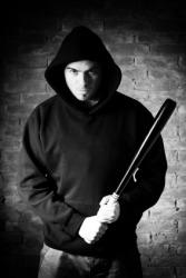 A hooligan weilding a bat.
