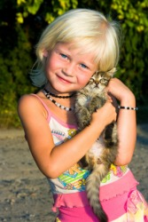 A little girl with a little cat.