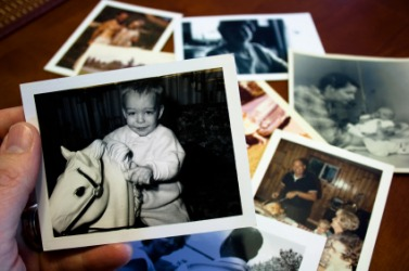 A person looks at old photos.