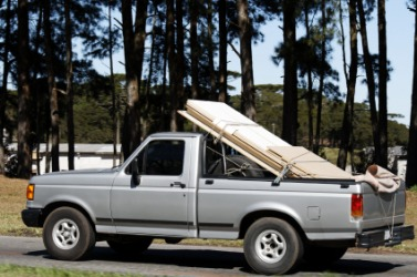 Boards loaded onto a pickup truck.