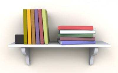 Books on an empty shelf.