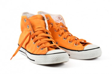 A pair of orange shoes.