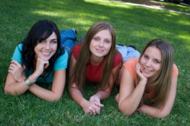 There are three girls in this photo.