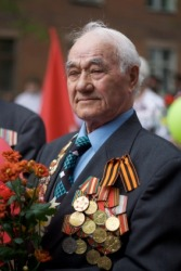 A veteran displays his medals.