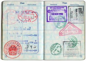 Many visas stamped on a passport.