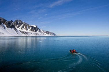 A boat travels the Arctic Ocean.