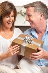 A woman accepts a gift.