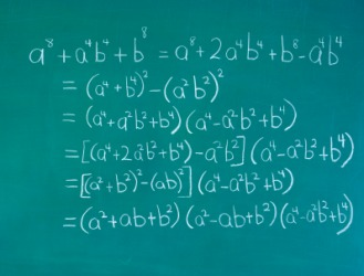 Examples of algebra on a chalkboard.