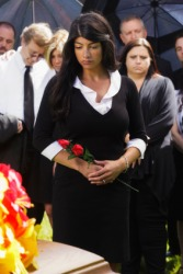 A woman grieves over the death of a loved one.