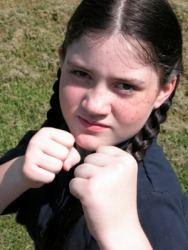 This little girl is ready to defend herself.