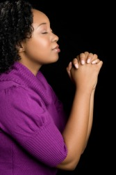 A devout woman praying.