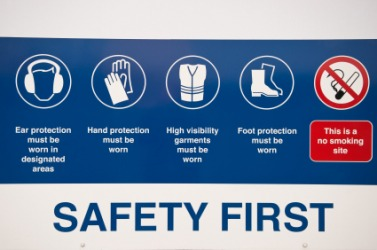 A sign promoting industrial safety.