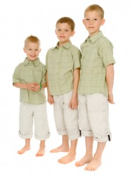 A middle child with his older and younger brothers.