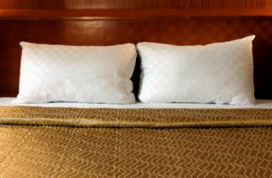 Two pillows on a bed.