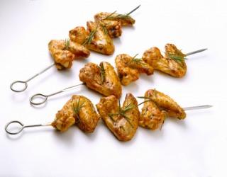 Chicken wings on a skewer.
