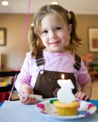 A little girl celebrating her birthday.