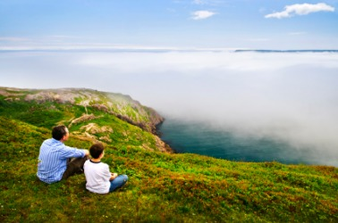 Father and son enjoy a beautiful vista.