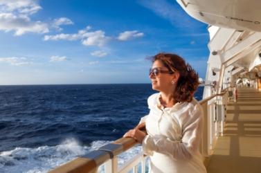 A woman enjoys her ocean voyage.