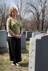 A widow visits her husbands grave.