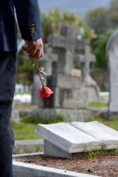 A widower at his wife's grave.