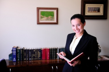 An attorney in  her office.