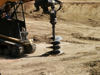 An auger is used to drill holes.