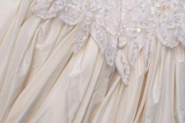 Gathered fabric on a wedding dress.