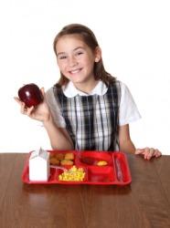 A girl eats her school lunch.