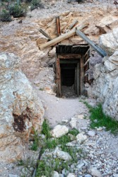 The entrance to an old abandoned mine.