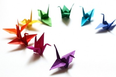 A rainbow of origami cranes.