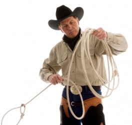 A cowboy using a rope.