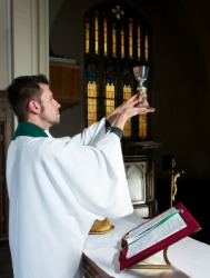 A priest celebrates mass.
