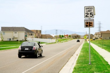 A sign shows this cars speed.