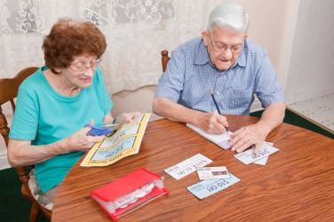 A couple being frugal by clipping coupons.
