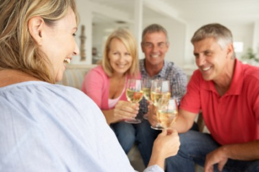 A group of people enjoy a glass of wine.