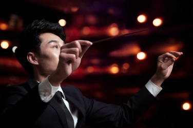 An orchestra conductor during a performance.