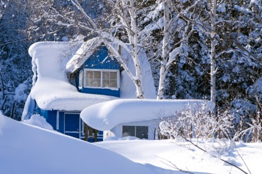 Snow has engulfed this house.
