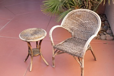 Outdoor furniture showing the effects of weathering.
