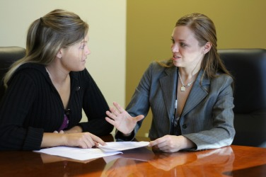 Two women having a dialogue.