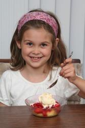 A little girl shows proper decorum.