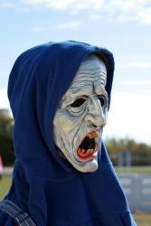 A person wearing a grotesque mask.
